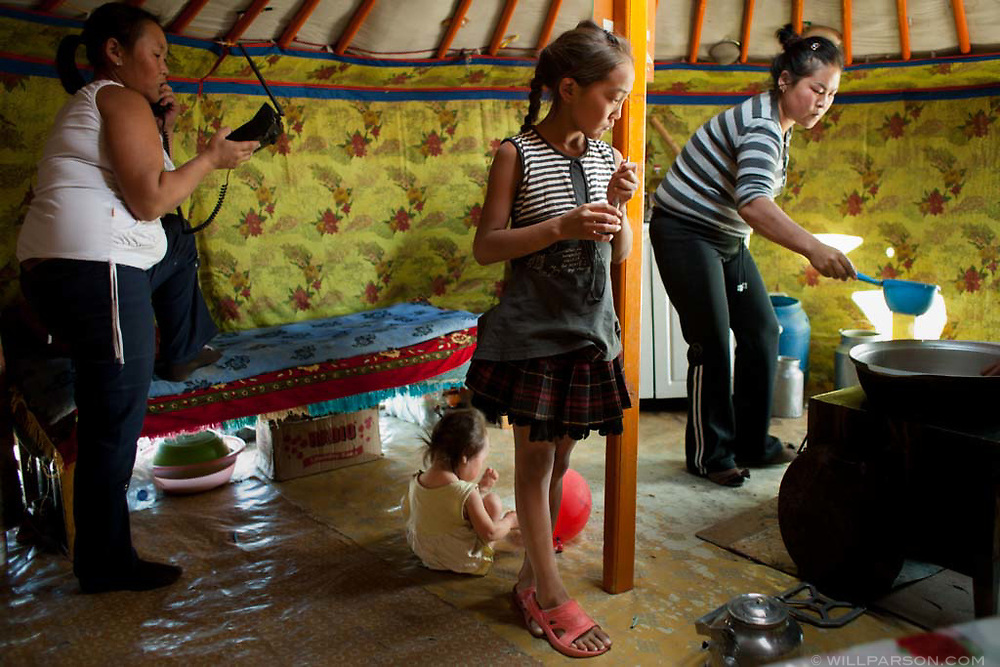 A family prepares a meal for British and American Mongol Rally customers in Govi-Altai Province.