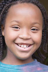 Portrait of a young girl smiling,