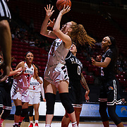 09 November 2018: San Diego State Aztecs center Zayn Dornstauder (22) takes a shot in the paint while being defended by Hawaii Warriors guard Julissa Tago (0) in the third quarter. The Aztecs opened up it's regular season schedule with a 58-57 win over Hawaii Friday at Viejas Arena.
