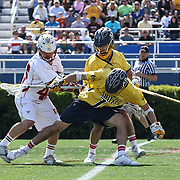 Drexel Midfielder Jason Klunder (10), CENTER, position himself towards the ball as Denver Midfielder Jeremy Noble (45), LEFT, defends in the second half of The NCAA Division I Men's Lacrosse Tournament game between the No. 5 seed Denver and No. 12 ranked Drexel Sunday, May. 18, 2014 at Delaware Stadium in Newark, DEL