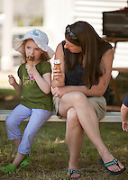 Brigid and Kate England enjoy an ice cream cone in the shade at the Sanbornton Old Home Day festivities on Saturday.   (Karen Bobotas/for the Laconia Daily Sun)Sanbornton Old Home Day parade and festivities July 16, 2011..
