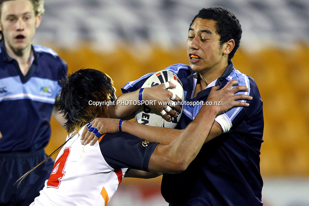 Whangaparaoa's Tuhoe Jones is tackled by Glenfield's Adam Neale. NZRL Under 85kg Secondary Schools Rugby League match, Whangaparaoa College v Glenfield College at Mt Smart Stadium, Auckland, New Zealand. Monday 10th September 2012. Photo: Anthony Au-Yeung / photosport.co.nz