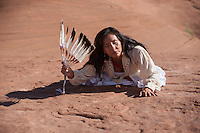 Native american woman touching sacred ground.