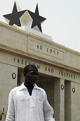 Ghana, Accra, 2007. Framed by Independence Square's black stars, a young man takes in the scene as thousands mark March 6th.