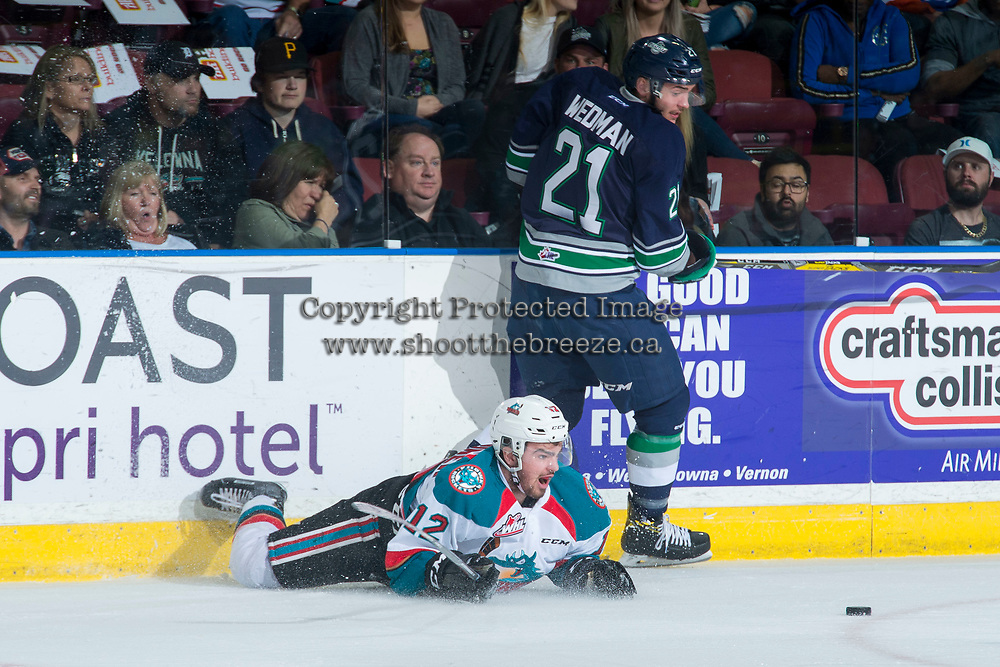 KELOWNA, CANADA - APRIL 26: Erik Gardiner #12 of the Kelowna Rockets is checked to the ice by Matthew Wedman #21 of the Seattle Thunderbirds on April 26, 2017 at Prospera Place in Kelowna, British Columbia, Canada.  (Photo by Marissa Baecker/Shoot the Breeze)  *** Local Caption ***