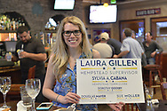 North Merrick, New York, USA. June 8, 2017.  Laurie Grab, sister of candidate Sue Moller, holds campaign sign for Democratic slate for Town of Hempstead.