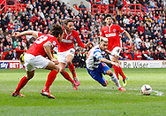 Daniel Williams of Reading (blue) draws a fould from Diego Poyet of Charlton Athletic (39) during the Sky Bet Championship match at The Valley, London<br /> Picture by Andrew Tobin/Focus Images Ltd +44 7710 761829<br /> 05/04/2014