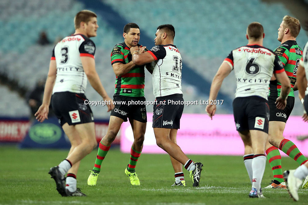 Cody Walker gets dealt with by Sam Lisone<br /> Rabbitohs v Warriors NRL rugby league match at ANZ Stadium, Homebush Australia. Friday 18 August 2017. Photo: Paul Seiser / www.photosport.nz