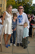 Damien Hirst and Maia Norman with their children Connor and Cassius ( younger). Mollie Dent-Brocklehurst and Vanity Fair host  the opening of 'Vertigo'  a mixed art exhibition at Sudeley Castle. Winchombe, Gloucestershire. 18 June 2005. ONE TIME USE ONLY - DO NOT ARCHIVE  © Copyright Photograph by Dafydd Jones 66 Stockwell Park Rd. London SW9 0DA Tel 020 7733 0108 www.dafjones.com