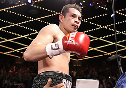 October 22, 2011; New York, NY; USA; Nonito Donaire (black trunks) and Omar Narvaez (red trunks) during their main event fight at the WAMU Theater in New York City.  Donaire won a unanimous 12 round decision.  Photo: Ed Mulholland/HBO