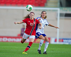 LLANELLI, WALES - Thursday, August 22, 2013: Norway's Andrea Thun in action against Finland's Tiia Peltonen during the Group B match of the UEFA Women's Under-19 Championship Wales 2013 tournament at Parc y Scarlets. (Pic by David Rawcliffe/Propaganda)