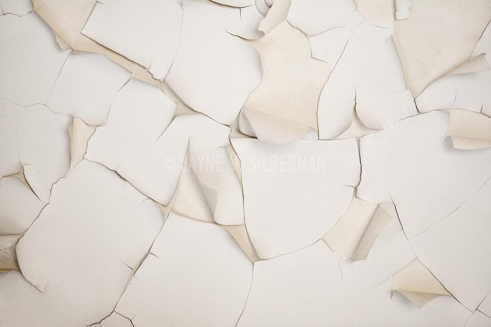 Peeling ceiling paint.