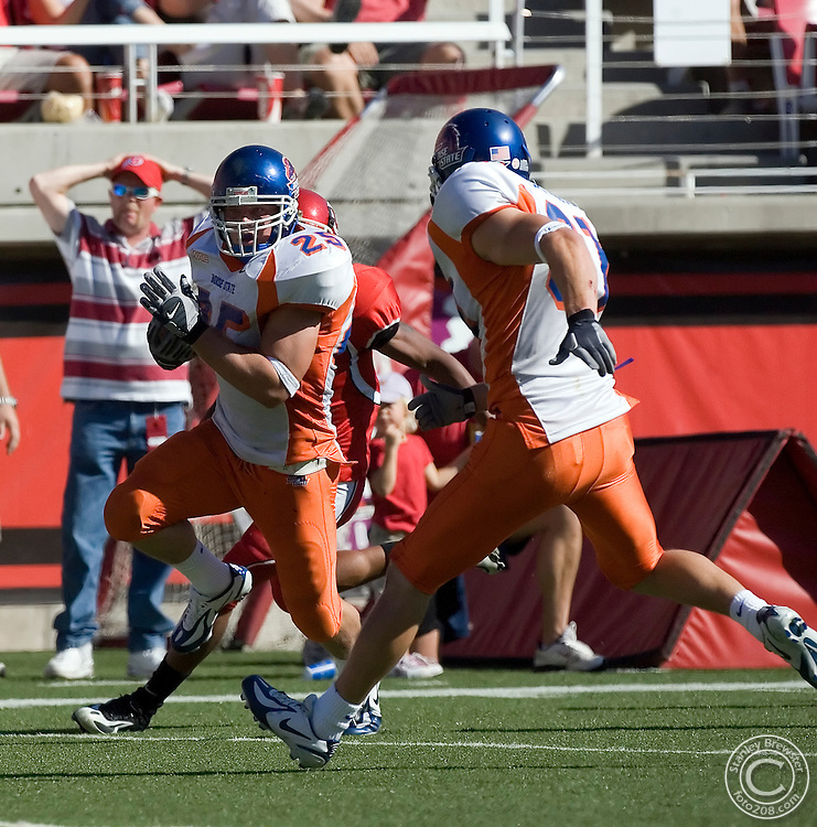 30 September 2006: Boise State linebacker Kory Hall returns an interception back for a touchdown as the Broncos beat the Utah Utes 36-3 in Rice-Eccles Stadium in Salt Lakes City Utah.