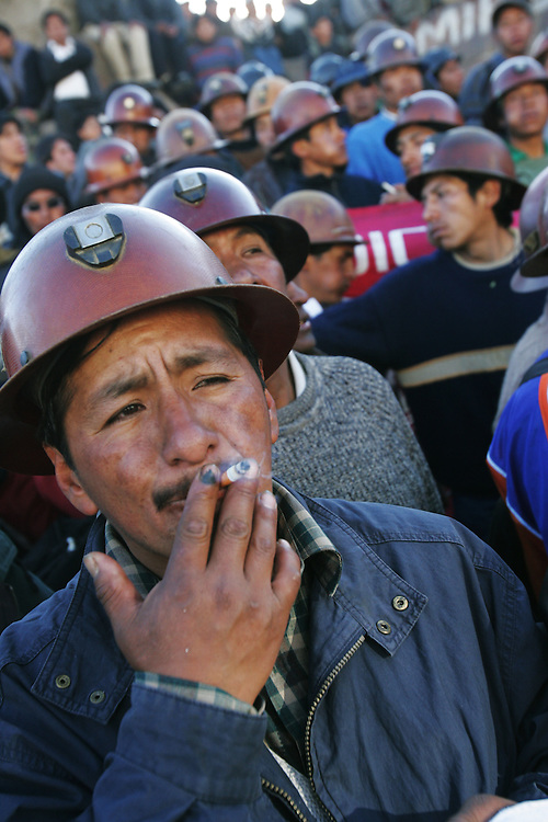 Miners congregate in La Paz's main plaza to protest, smoke and chew coca leaves. Three weeks of protests that have rocked Bolivia led to President Mesa offering his resignation, for the second time this year, to congress. Blockades, protests and concentrations have brought the country to a standstill and confrontations between police and protestors happen daily.  At the center of the conflict is the indigenous movement's desire to nationalize gas and rewrite the constitution. Congress must now meet to decide of they will accept the president's resignation.