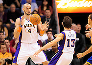 Jan. 2, 2012; Phoenix, AZ, USA; Phoenix Suns center Marcin Gortat (4) reacts to a pass made by teammate Steve Nash (13) against  the Golden State Warriors during the first half at the US Airways Center. The Suns defeated the Warriors 102-91. Mandatory Credit: Jennifer Stewart-US PRESSWIRE.