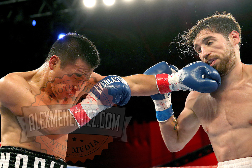 Puerto Rican Olymian Jeyvier Cintron (R) gets punched in the face by Edson Noria during a Telemundo boxing match between at Osceola Heritage Park on Friday, February 23, 2018 in Kissimmee, Florida.  (Alex Menendez via AP)