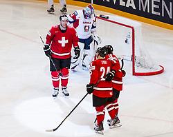 08.05.2013, Globe Arena, Stockholm, SWE, IIHF, Eishockey WM, Slowenien vs Schweiz, im Bild Switzerland (Schweiz) 51 Ryan Gardner, jubel glädje lycka glad happy, Slovenia (Slovenien) 33 Robert Kristan, Switzerland (Schweiz) 24 Reto Suri // during the IIHF Icehockey World Championship Game between Slovenia and Switzerland at the Ericsson Globe, Stockholm, Sweden on 2013/05/08. EXPA Pictures © 2013, PhotoCredit: EXPA/ PicAgency Skycam/ Johan Andersson..***** ATTENTION - OUT OF SWE *****