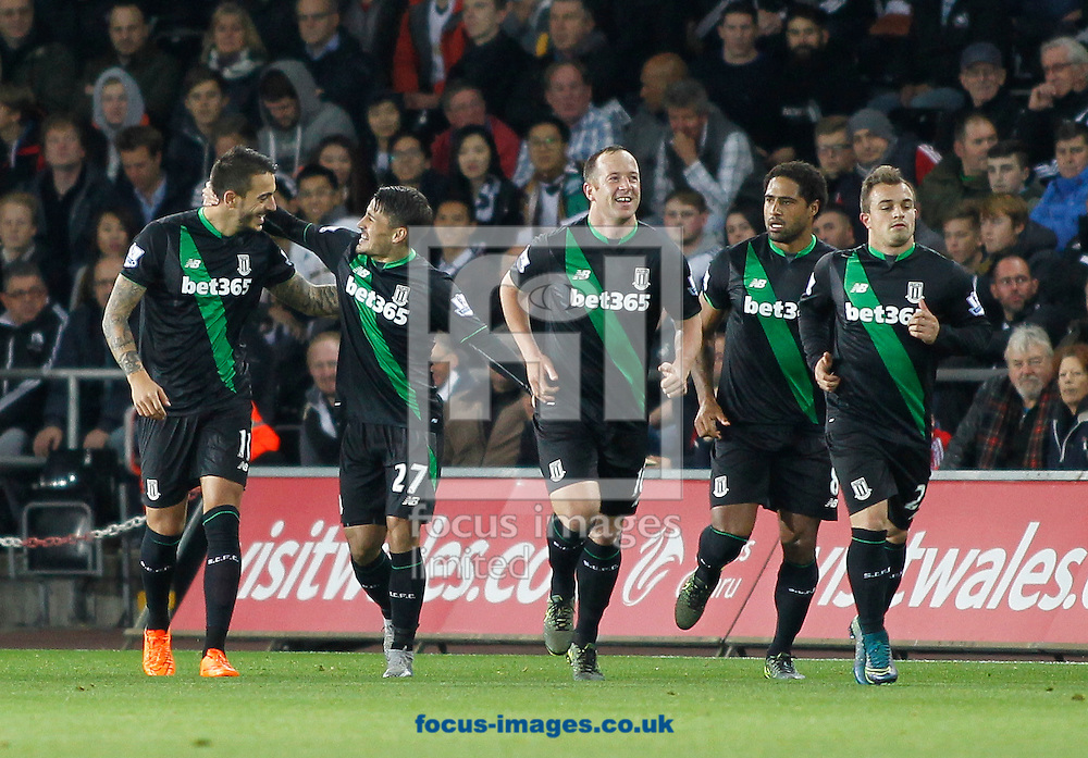 Bojan Krkic (2nd L) of Stoke City celebrates the first goal with team mates during the Barclays Premier League match at the Liberty Stadium, Swansea<br /> Picture by Mike Griffiths/Focus Images Ltd +44 7766 223933<br /> 19/10/2015
