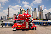 A vendor sells Coke along the Bund promenade Shanghai, China