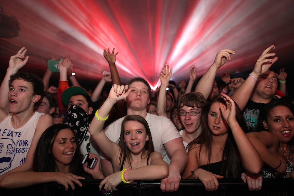 People dance as dubstep artist Excision plays at the Egyptian Room  January 25, 2013. .Photo by Chris Bergin