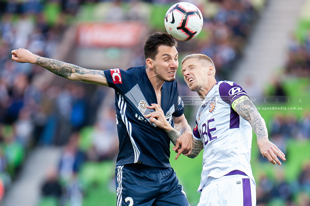 Melbourne Victory defender Storm Roux (2) wins the header at the Hyundai A-League Round 2 soccer match between Melbourne Victory and Perth Glory at AAMI Park in Melbourne.