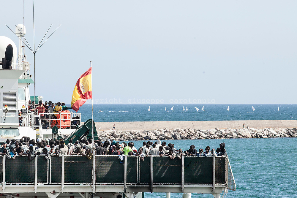 "29 June 2017, Salerno Italy - Arrived at the port of Salerno the Spanish ship ""Rio Segura"" with 1216 migrants aboard. On board 11 pregnant womans , 256 children of which 13 newborns. The nationalities are: Congo, Nigeria, Ghana, Mali, Gambia, Niger, Guinea, Sudan, Senegal, Bangladesh, Pakistan, Cameroon. 300 people will remain in Campania, 150 in Piedmont, 75 in Tuscany, 96 in Lombardy, 75 in Veneto, 50 in Abruzzo and the same in Molise, Friuli Venezia Giulia, Marches, Trento and Bolzano, Basilicata and Umbria, 100 in Emilia- Romagna, 39 in Liguria, 11 in Aosta Valley. Around 260,000 people arrived in the United States and requested asylum, 120,000 in Italy, and France and Turkey each took in around 80,000. Sources by The Organisation for Economic Co-operation and Development (OECD)."