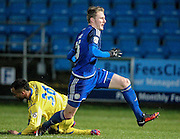 Kieran Sadler (Halifax) goes past the challenge of James Hurst (Guiseley) during the Conference Premier League match between FC Halifax Town and Guiseley at the Shay, Halifax, United Kingdom on 5 December 2015. Photo by Mark P Doherty.