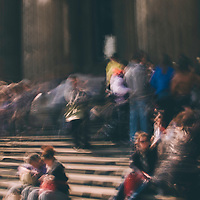 A blurry abstract photo of a group of people on some steps