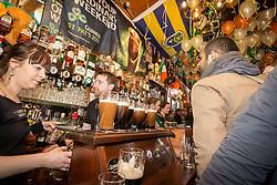 St Patrick's Day celebration in Irish pub, Stoke Newington, London UK 2013