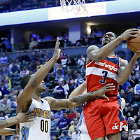 08 March 2017: Washington Wizards guard Bradley Beal (3) goes for the reverse layup past Denver Nuggets forward Darrell Arthur (00) during the Washington Wizards 123-113 victory over the Denver Nuggets, at the Pepsi Center, Denver, Colorado, USA.