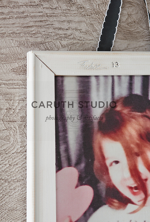 Detail of photo booth images printed on fabric and framed