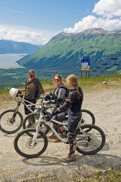 Alaska, Alyeska Resort. Llift accessed, mountain biking on the slopes of Mt Alyeska,  in summer, with views of the Chugach Mountains and Turnagain Arm.