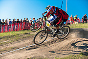 Kyle Strait rounds the last turn of the Sea Otter Slalom mountain bike race in the final round and extends his lead on Australian Troy Brosnan to win the event.