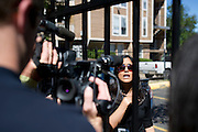City of Dallas spokeswoman Sana Syed speaks with the media outside the Ivy Apartments where Thomas E. Duncan, the first confirmed Ebola virus patient in the United States, was staying with family in Dallas, Texas on October 3, 2014. Duncan is now being treated at Texas Health Presbyterian Hospital Dallas while members of his family have been isolated in the apartment. (Cooper Neill for The New York Times)