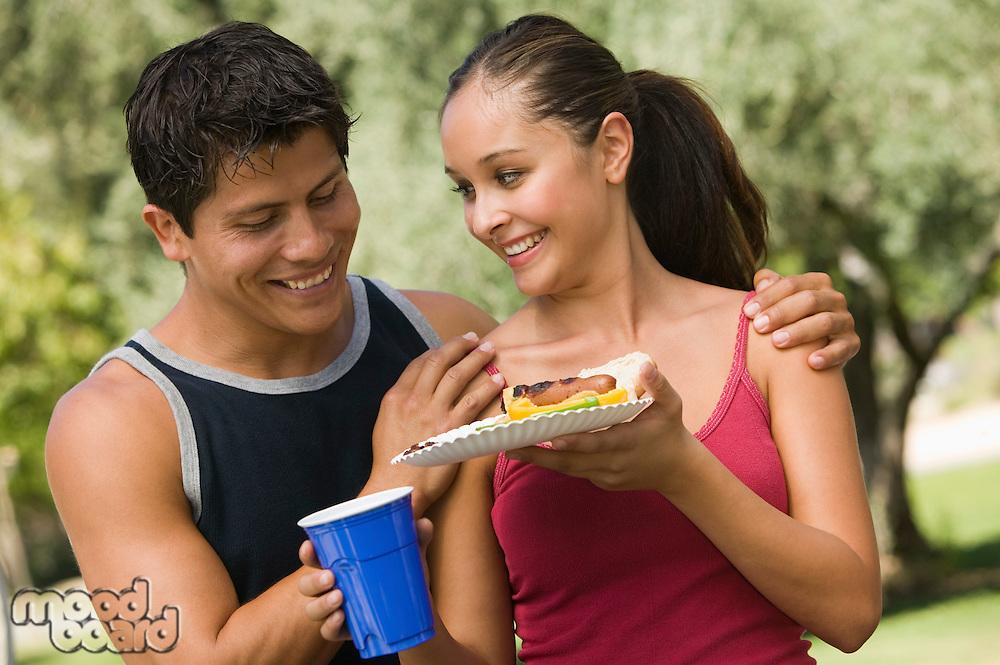 Couple Sharing Food at Picnic