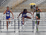 Hampton's Breana Norman (123) and Racquel Vassell (129) along with Norfolk State's Wanetta Kirby (273) compete in the second heat of the Women's 100 Meter Hurdles in a torrential down pour at the 2011 MEAC Track and Field Championship held at North Carolina A&T in Greensboro, North Carolina.  (Photo by Mark W. Sutton)