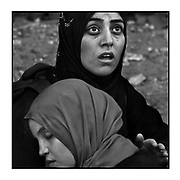 Faces of Mosul<br /> <br /> A collection of images from 4 time Pulitzer prize winning photographer Carol Guzy, gives us a glimpse into the faces of those affected by the fierce conflict with ISIS in Mosul. Wounded and weak, most who survived now face an uncertain future in the limbo of IDP camps. Shattered lives, lost loved ones and escape from the rubble of collapsed homes and the evil of ISIS doctrine, leaves scars of emotional trauma even more difficult to heal. The war in Mosul is over, but the humanitarian crisis continues.<br /> Mosul, Iraq - Civilians, many wounded and weak, arrive at a medical Trauma Stabilization Point near the Old City as they flee the fierce battle with ISIS in West Mosul amid ruins of the city.  Those not severely injured continue walking after being checked for suicide bombs and are then transported.<br />  ©Carol Guzy/zReportage.com/Exclusivepix Media
