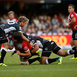DURBAN, SOUTH AFRICA - APRIL 09:  Joe Pietersen of the Cell C Sharks and Franco Marais of the Cell C Sharks tackle Franco Mostert of the Emirates Lions during the 2016 Super Rugby match between Cell C Sharks and Emirates Lions at Growthpoint Kings Park on April 09, 2016 in Durban, South Africa. (Photo by Steve Haag/Gallo Images)