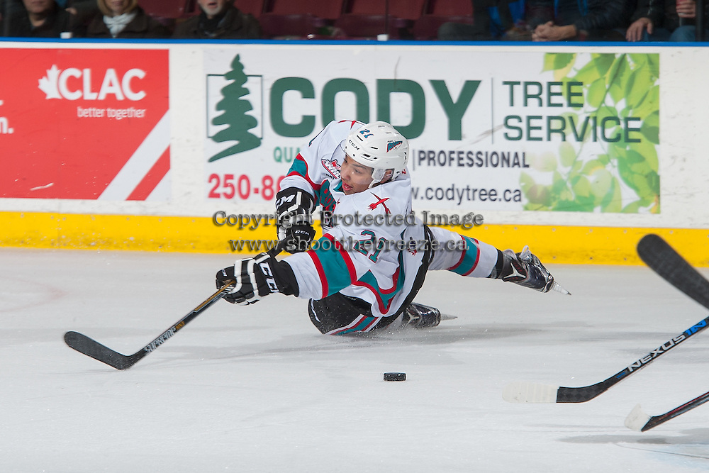 KELOWNA, CANADA - JANUARY 29: Devante Stephens #21 of Kelowna Rockets loses his footing on a shot against the Portland Winterhawks on January 29, 2016 at Prospera Place in Kelowna, British Columbia, Canada.  (Photo by Marissa Baecker/Shoot the Breeze)  *** Local Caption *** Devante Stephens;