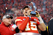 Kansas City Chiefs quarterback Patrick Mahomes holds the Lamar Hunt Trophy as he celebrates winning a NFL, AFC Championship football game against the Tennessee Titans, Sunday, Jan. 19, 2020, in Kansas City, MO. The Chiefs won 35-24 to advance to Super Bowl 54. (AP Photo/Colin E. Braley) Colin Eric Braley Photography
