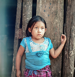 Five years old Maria Tiñu Kinus father has work some five months a year. In the village where they live, Nuevo Provendencia, residents have with help from the Church bought land from a large farm. Even so, nearly 70 percent of the village's children are still chronically malnourished. Local peasant organizations educate villagers to become self-sufficient, in this transition from day laborers to small independent farmers.