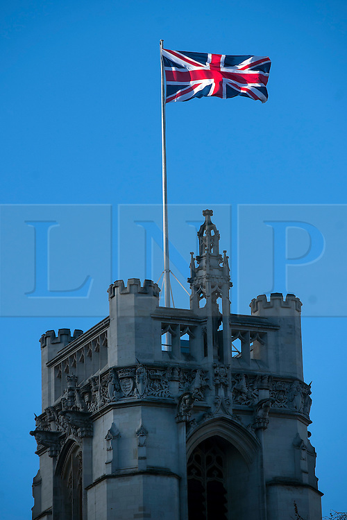 © Licensed to London News Pictures. 31/12/2015. London, UK. The Union Flag, also known as the Union Jack, flying upside down above the Supreme Court in Westminster, London on December 31, 2015. If the union flag is flown the correct way up the red stripe in the top left corner is at the bottom of the white space around it. Photo credit: Ben Cawthra/LNP