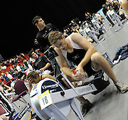 Birmingham, Great Britain,   Men's open weight  Cameron NICOL exhausted after winning the silver medal at the British Indoor Rowing Championships, National Indoor Arena, NIA, Sun, 22.11.2009  [Mandatory Credit. Peter Spurrier/Intersport Images]