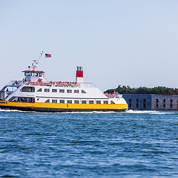 A Maine State Ferry near Fort Gorges in Casco Bay, Portland, Maine.