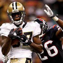 August 21, 2010; New Orleans, LA, USA;  New Orleans Saints wide receiver Adrian Arrington (87) catches a pass over Houston Texans safety Eugene Wilson (26) during the second quarter of a preseason game at the Louisiana Superdome. Mandatory Credit: Derick E. Hingle