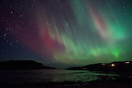 The Northern Lights or Aurora Borealis light up the sky over Inverkirkaig, nort west Scotland, on the night on the 27th February 2014. The display lasted two hours before clouds rolled in to obscure it. Photography copyright Andrew Tobin/tobinators.com.