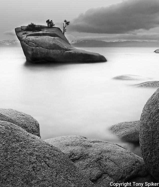 """Bonsai Rock 1"" - A black and white photograph of a morning sunrise at Bonsai Rock, on Lake Tahoe's Eastern shore"