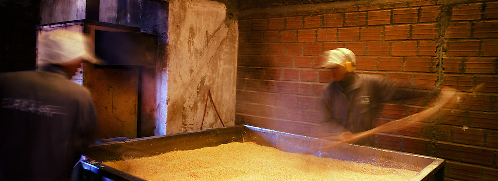 """Workers process the harvested quinoa in a small factory in Challapata, Bolivia. .The nutritional qualities of the seed have generated a new export market for South American farmers. Demand for the grain-like seed are increasing due to its nutritional benefits. Quinoa contains more protein than any other """"grain"""" and includes all eight essential amino acids needed for tissue development. Quinoa has been cultivated in the Andes since 3000BC. Challapata, Bolivia, 12th May 2011. Photo Tim Clayton"""