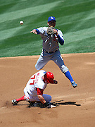ANAHEIM, CA - MAY 17:  Second baseman Luis Maza #57 of the Los Angeles Dodgers forces Reggie Willits #77 of the Angels at second base as he leaps over the sliding baserunner and thows to first base on a double play attempt during the game against the Los Angeles Angels of Anaheim at Angel Stadium in Anaheim, California on May 17, 2008. The Dodgers defeated the Angels 6-3. ©Paul Anthony Spinelli *** Local Caption *** Luis Maza;Reggie Willits
