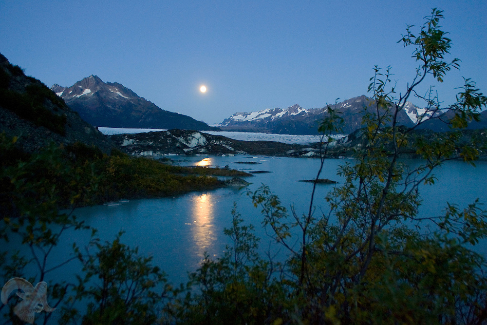 Photo by Bob Martinson<br /> As the full moon rises over Sheridan Glacier near Cordova, Alaska, on September 28, 2007, light reflects off the newly forming ice on what locals call, &quot;Glacier Lake,&quot; a popular ice skating area during winter.